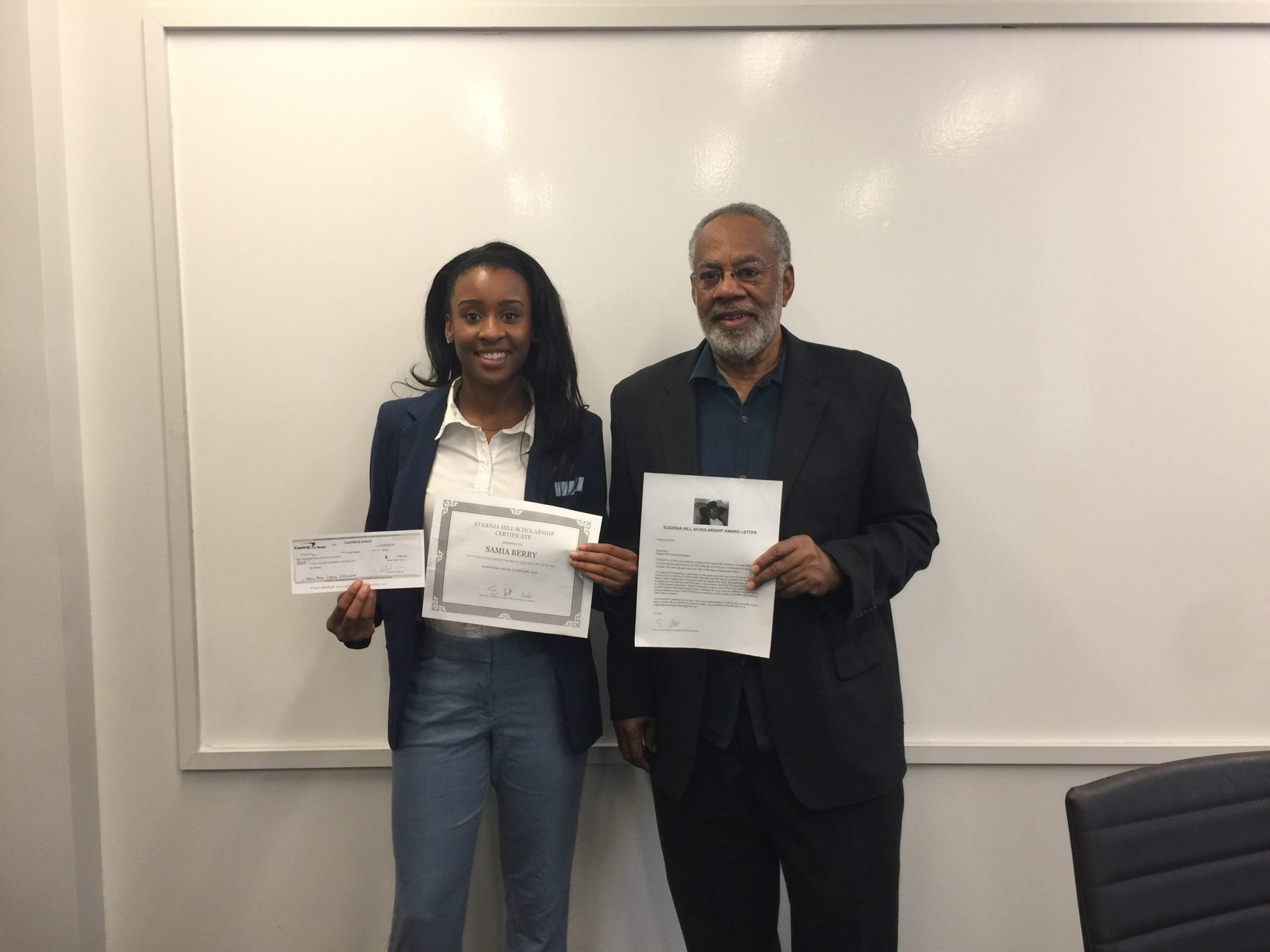 2018 Recipient Samia Berry and Dean Davis holding scholarship check